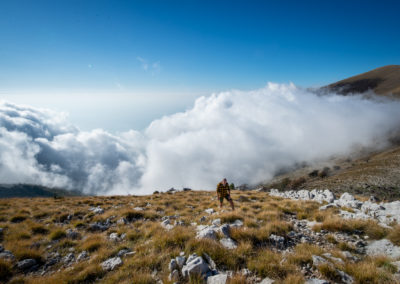 Hiking above the clouds in the mountains of Dukat, Albania.