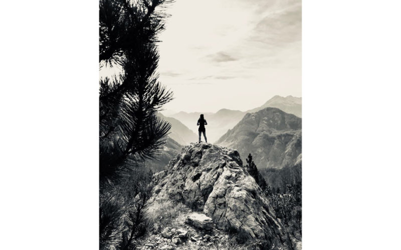 Woman standing on a rock in Theth, Albania