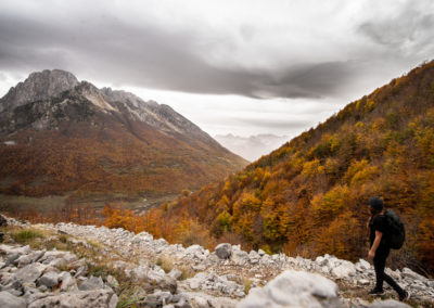 Walking in the mountains of Albania on a autumn day. Cloudy and autumn leaves.