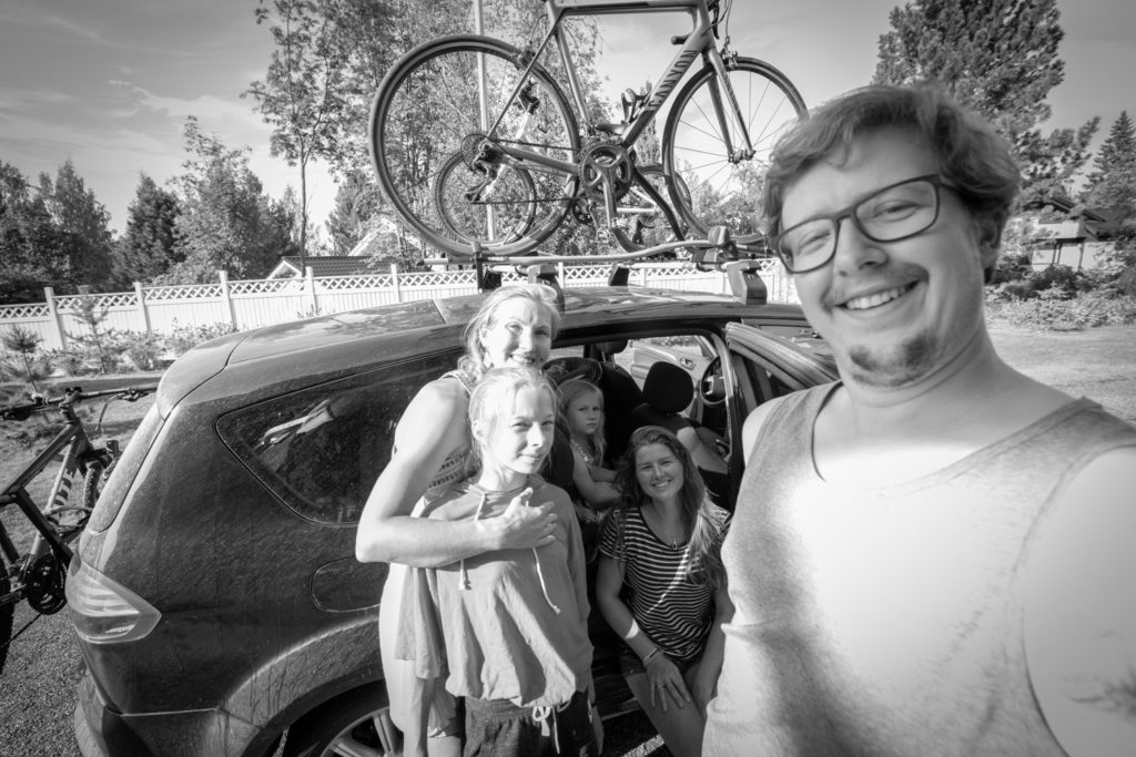 Black and white selfie of Ellis and me and a family